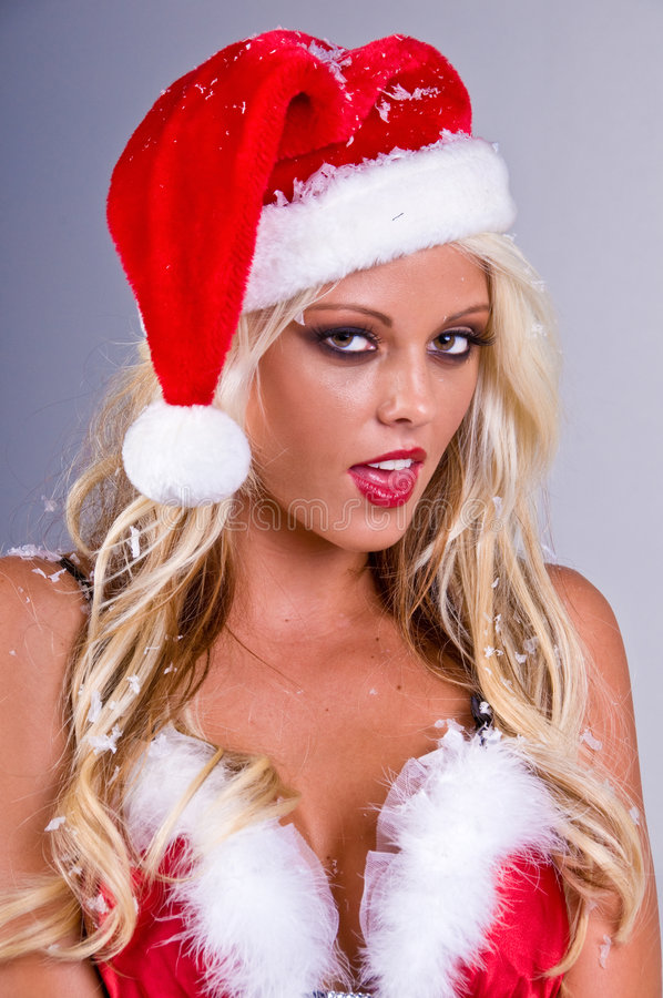 Blond Santa Woman With Snow stock photo