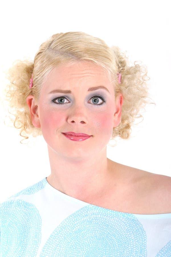 blond seende förvånad kvinna royaltyfri bild
