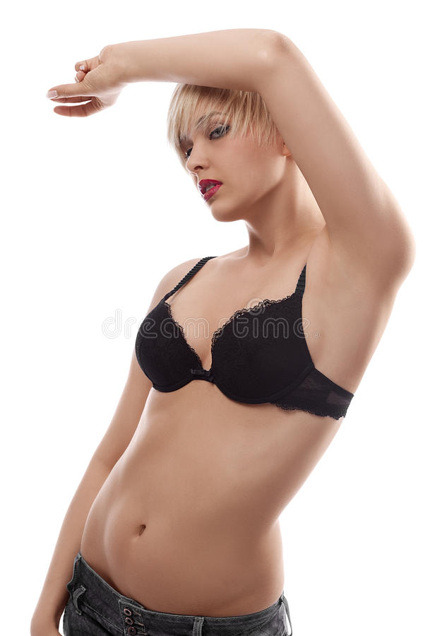 Blond Sensual Girl In Lingerie Posing Against Stock Image