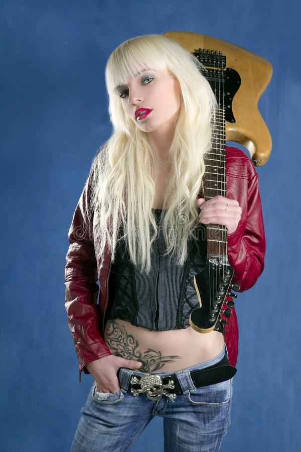 Blond fashion young girl electric guitar rock stock image