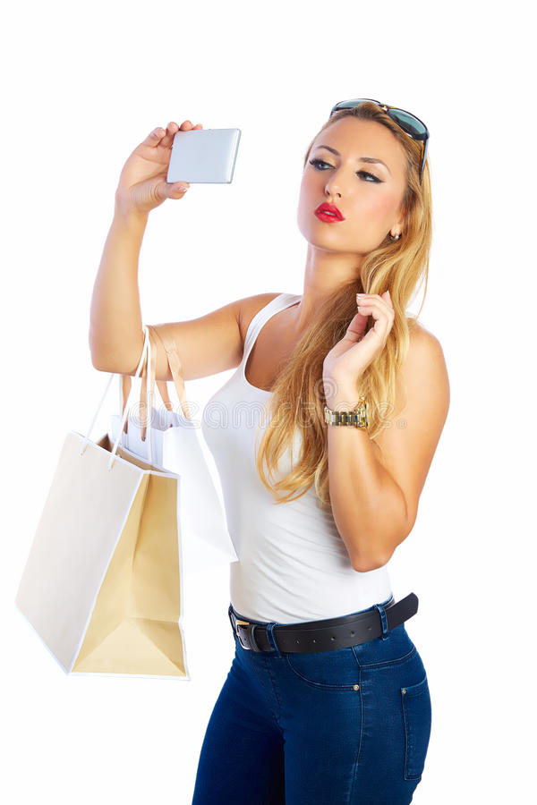 Blond shopaholic kobiet torby, smartphone i obrazy stock