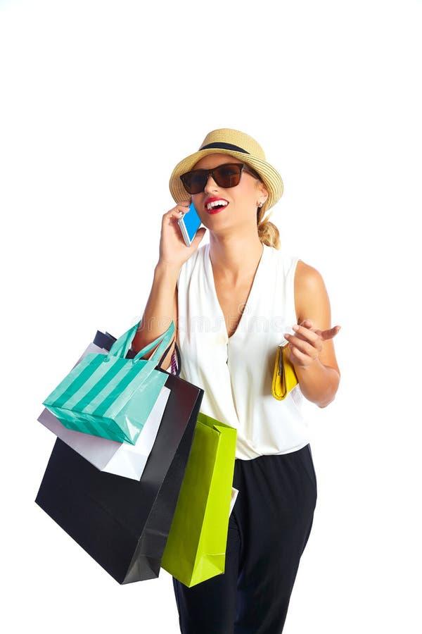 Blond shopaholic kobiet torby, smartphone i zdjęcie royalty free