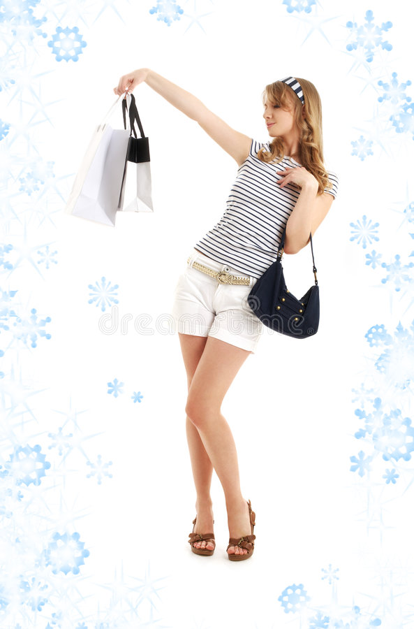 Blond with shopping bags and snowflakes stock image