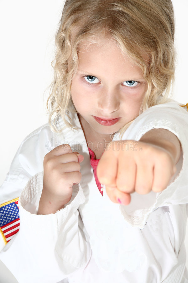 Blond six year old girl doing stock image