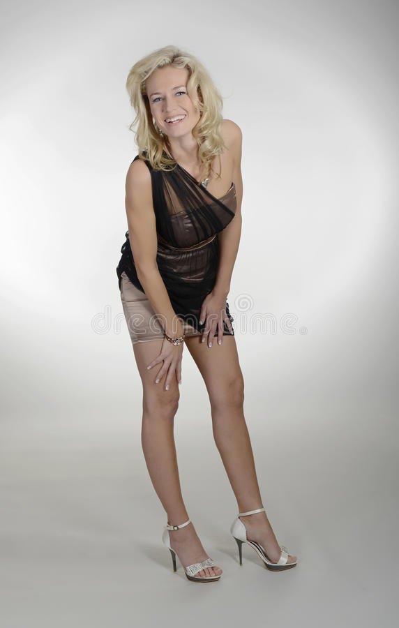 blond skratta kvinna royaltyfri foto