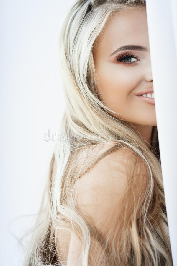 Blond smiling woman stock images
