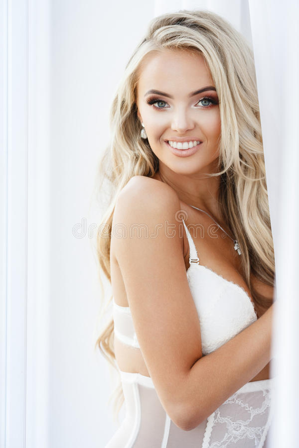 Blond smiling woman royalty free stock image
