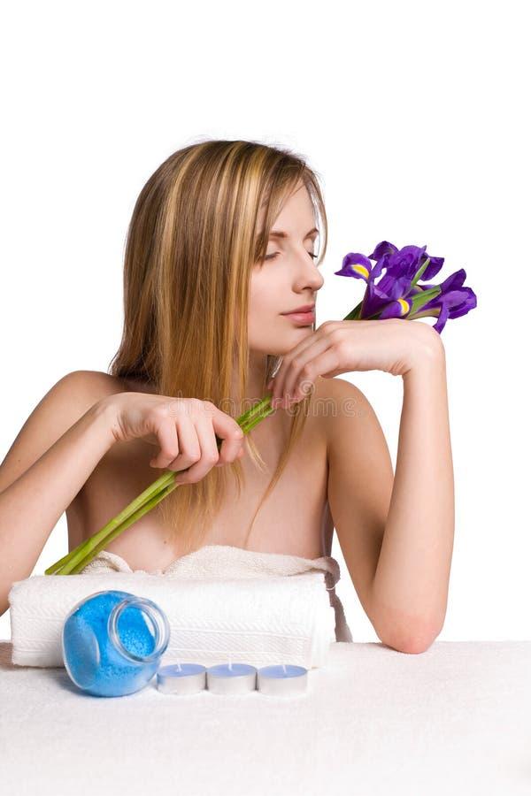 Blond spa girl with iris flowers. royalty free stock photos