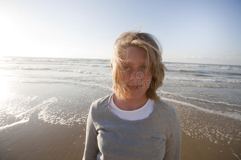 Blond, teenage girl at the beach stock photos