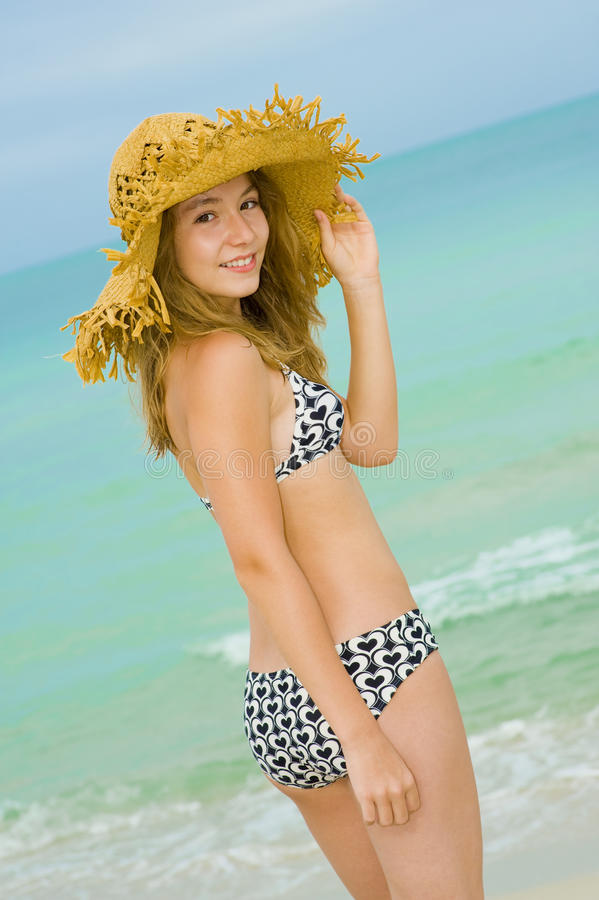 Blond teenager at the beach. Blond teenager model posing at the beach stock photos