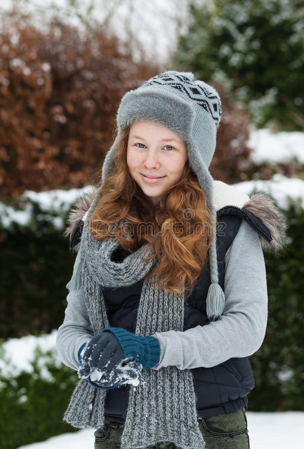 Download Blond Teenager Girl Making A Snowball In Snowy Park Stock Photo - Image of jacket, outdoors: 105228262