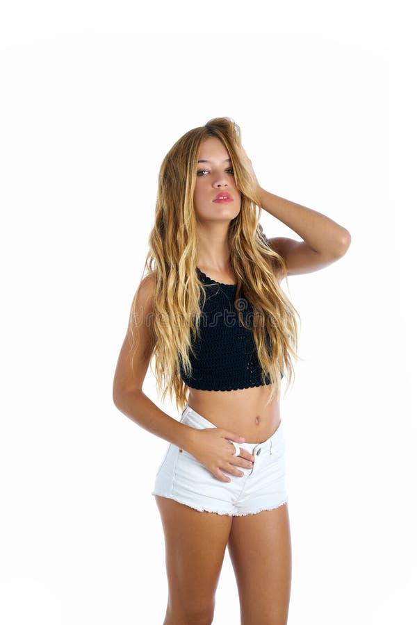Blond teenager girl touching hair on white royalty free stock image