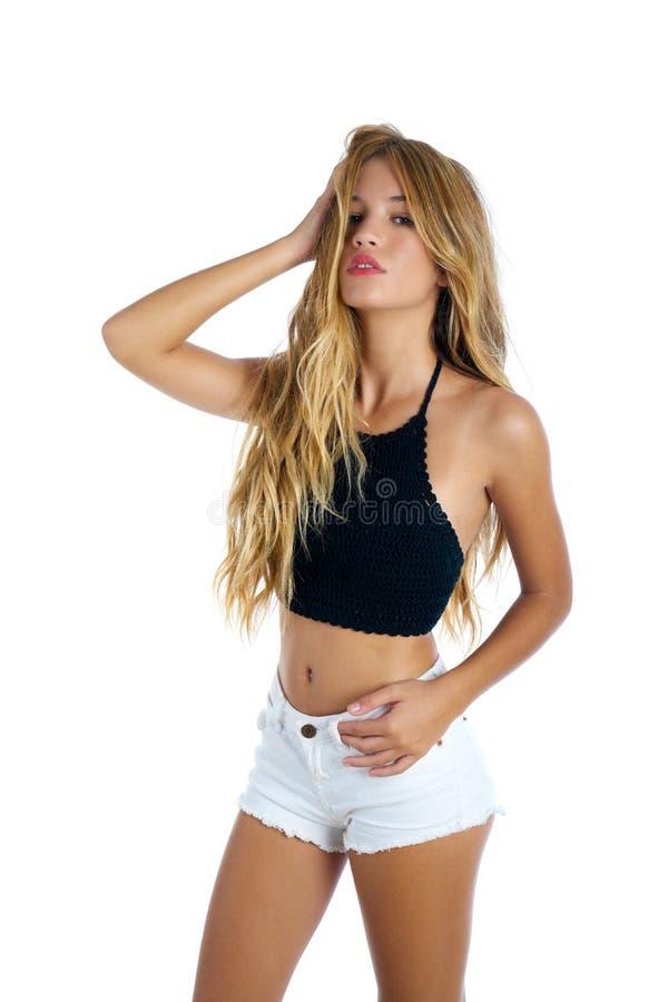 Blond teenager girl touching hair on white royalty free stock photo