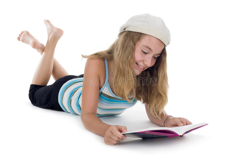 Blond teenager reading a book. Isolated on white background stock image