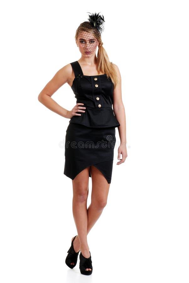 Blond teenager wearing black dress and veil head p