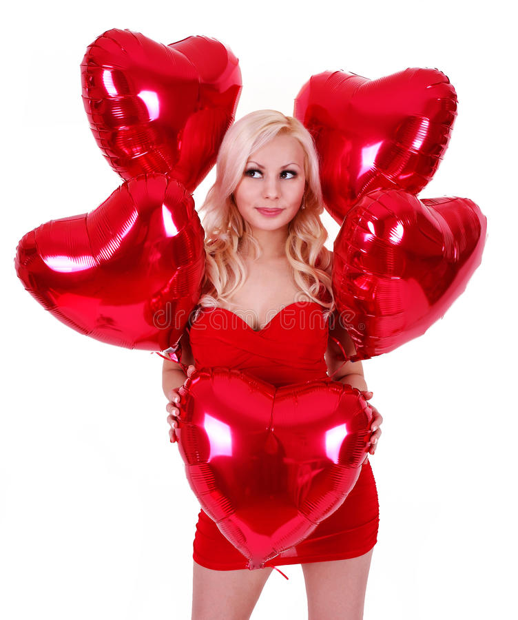 Blond ung kvinna med ballonger för valentindag arkivbilder