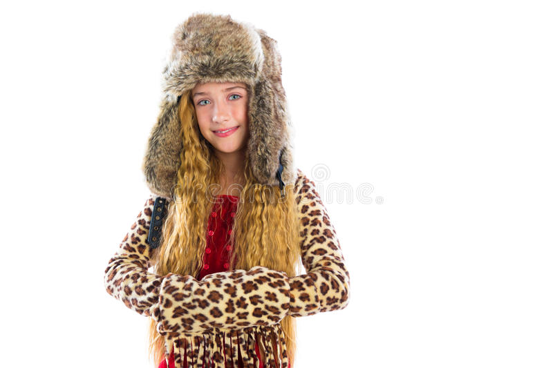 Blond winter kid girl long hair with fur clothes stock photos