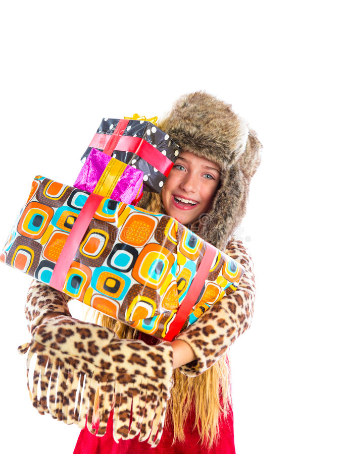 Blond winter kid girl with stacked presents smiling stock photos