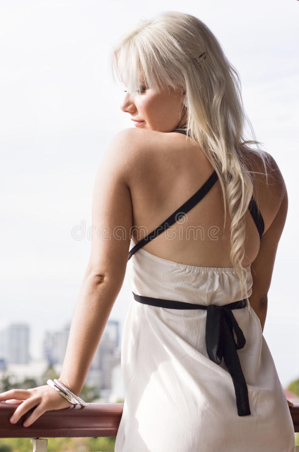 Download Blond woman on balcony stock image. Image of elegance - 14827879