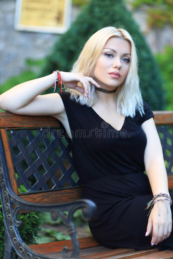 Blond woman. Beauitul blond woman posing near castle wall royalty free stock images