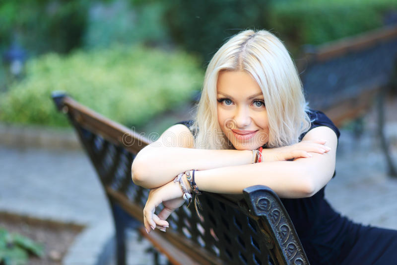 Blond woman. Beauitul blond woman posing near castle wall stock images