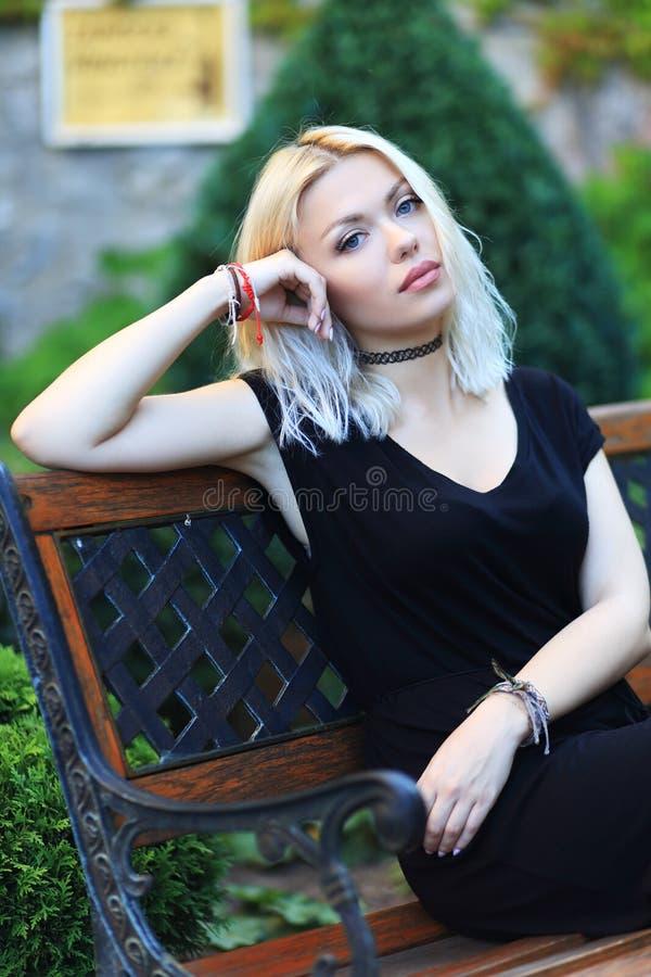 Blond woman. Beauitul blond woman posing near castle wall stock photography