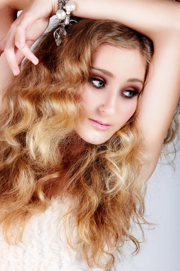 Blond woman with big hair stock photos