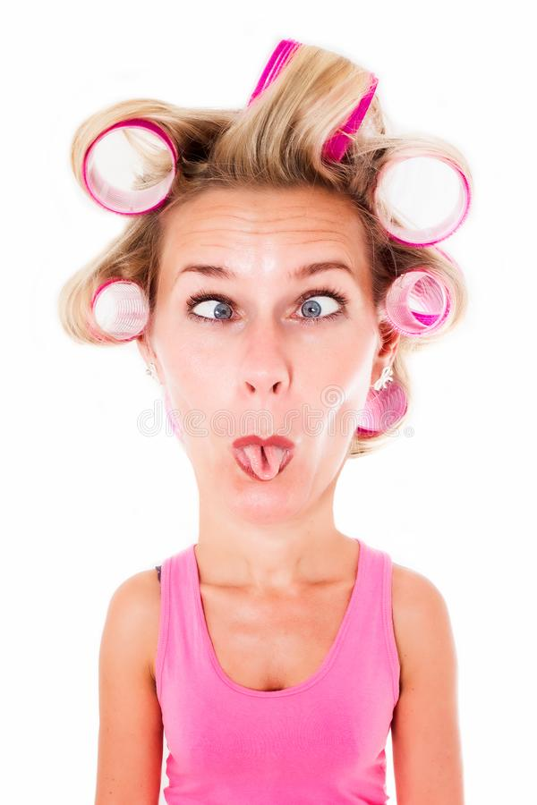 Blond woman with big head and curlers making goofy face royalty free illustration