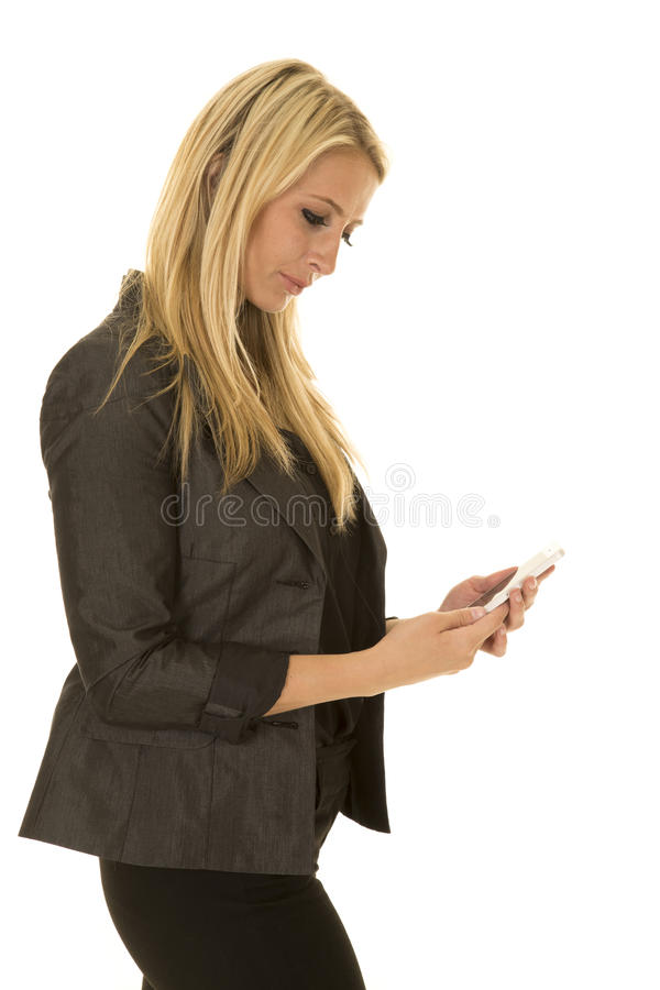 Blond woman in black business attire side text look down stock image