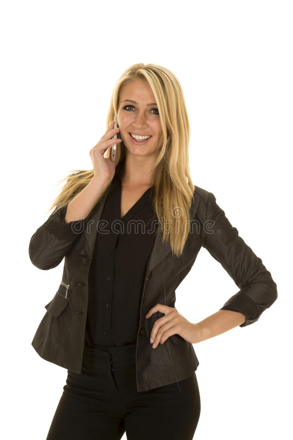 Blond woman in black business attire talk on phone smile royalty free stock images