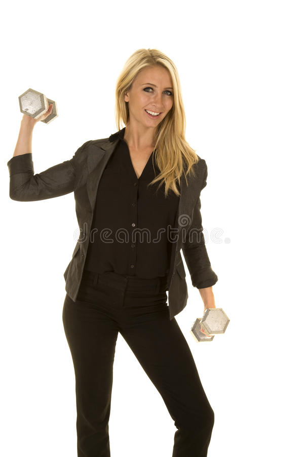 Blond woman in black business attire weights one up royalty free stock image