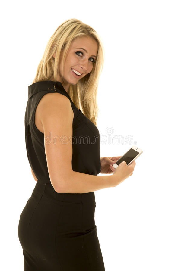 Blond woman black business dress side looking hold phone stock photo