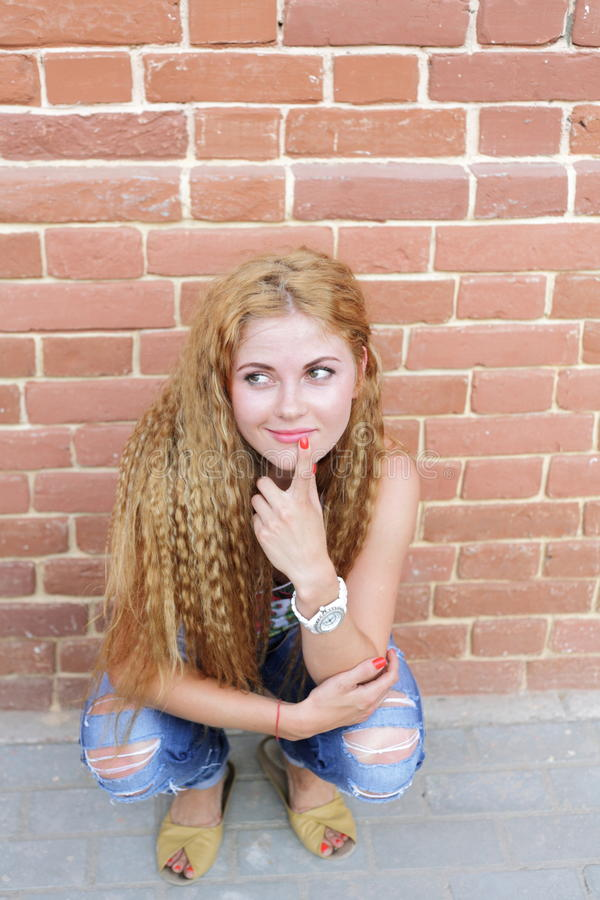 Download Blond Woman And Brick Wall stock photo. Image of copyspace - 26438528