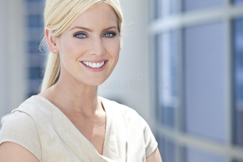 Download Blond Woman Or Businesswoman With Blue Eyes Stock Photo - Image: 27576194