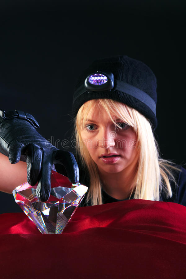 Free Blond Woman Cat Burglar Stealing A Large Diamond Royalty Free Stock Images - 9928129