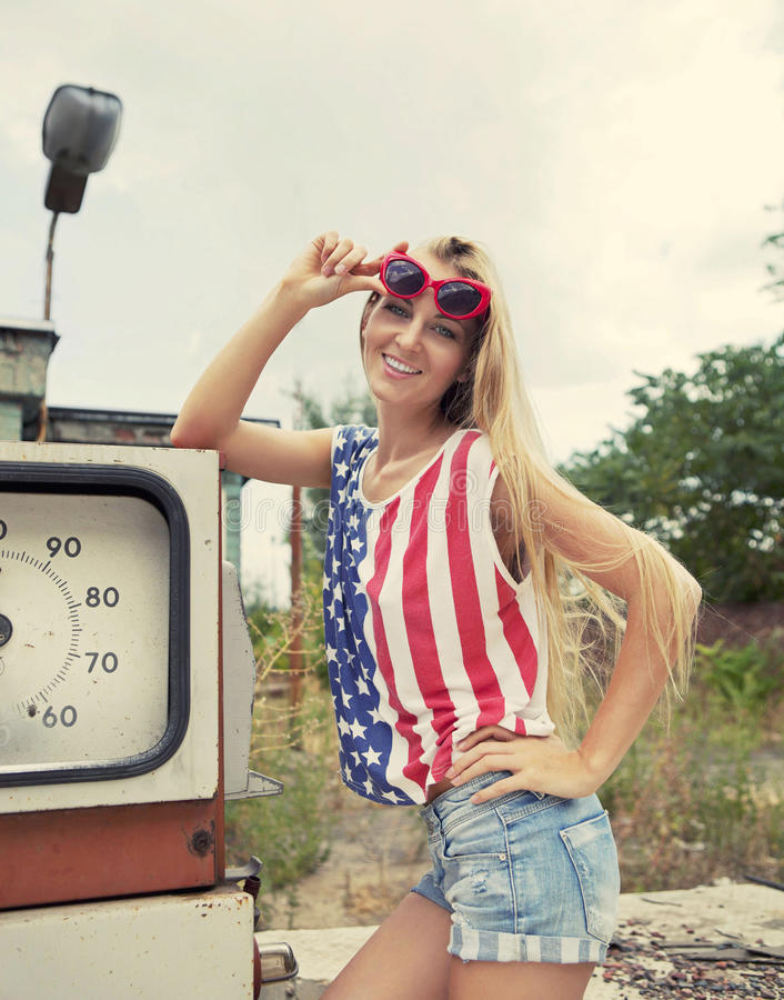 Blond Woman On Damaged Gas Station Royalty Free Stock Images