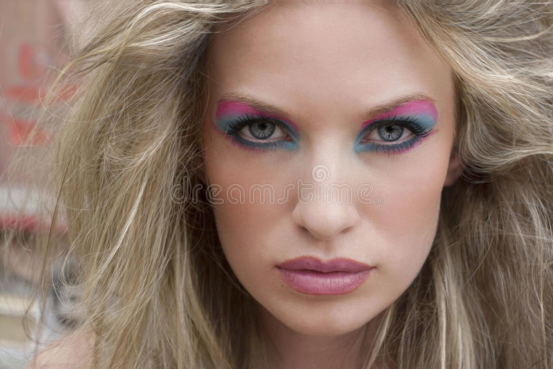 Blond woman with dramatic eyes stock image
