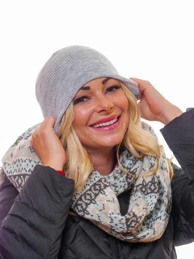 Blond woman dressed for winter stock photos