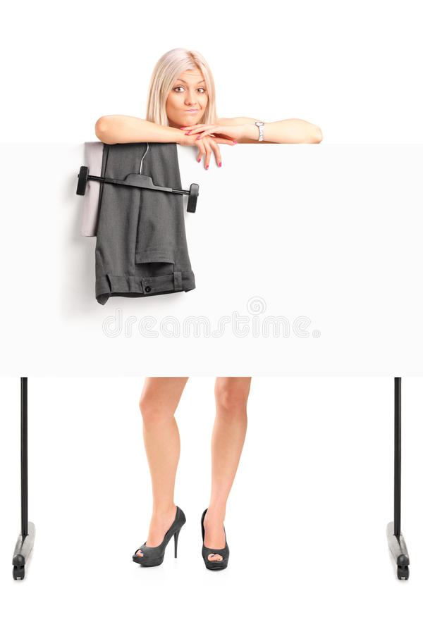 Download Blond Woman Dressing Up Behind Panel Stock Image - Image: 25900335