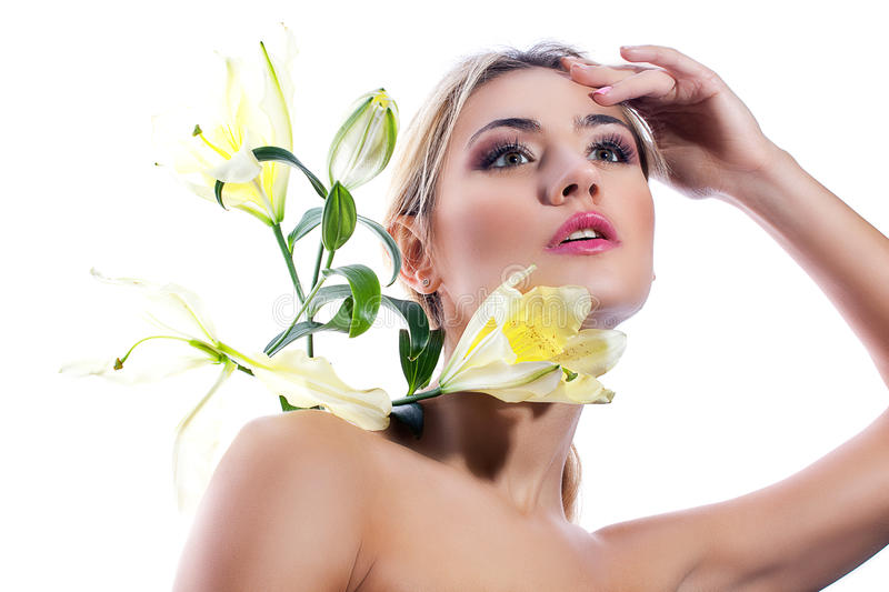 Blond woman with fresh clean skin and white lily flower isolated stock images