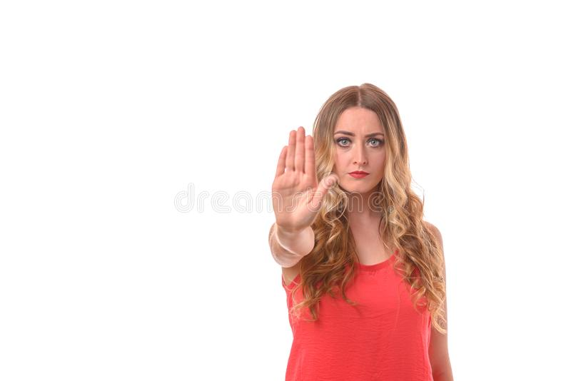 Blond woman giving a halt sign or gesture royalty free stock image