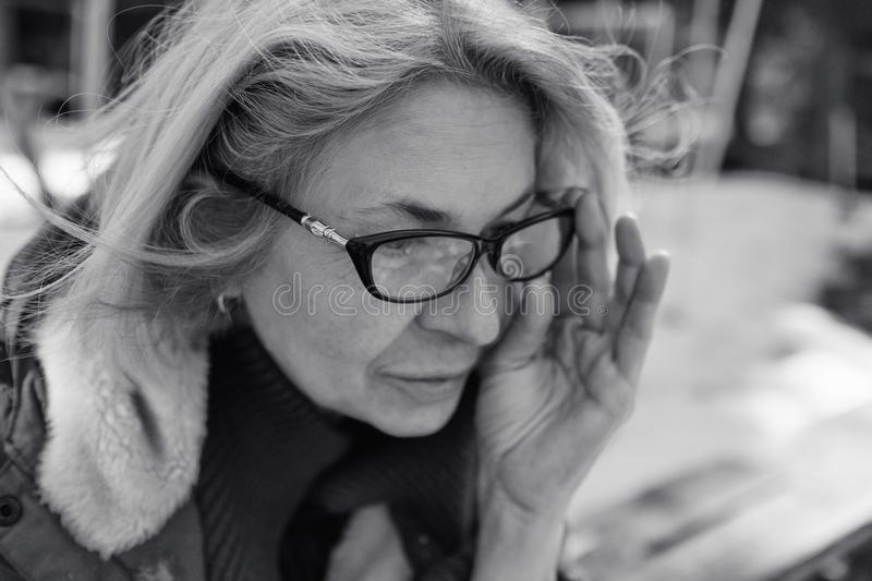 Blond Woman In Glasses royalty free stock images