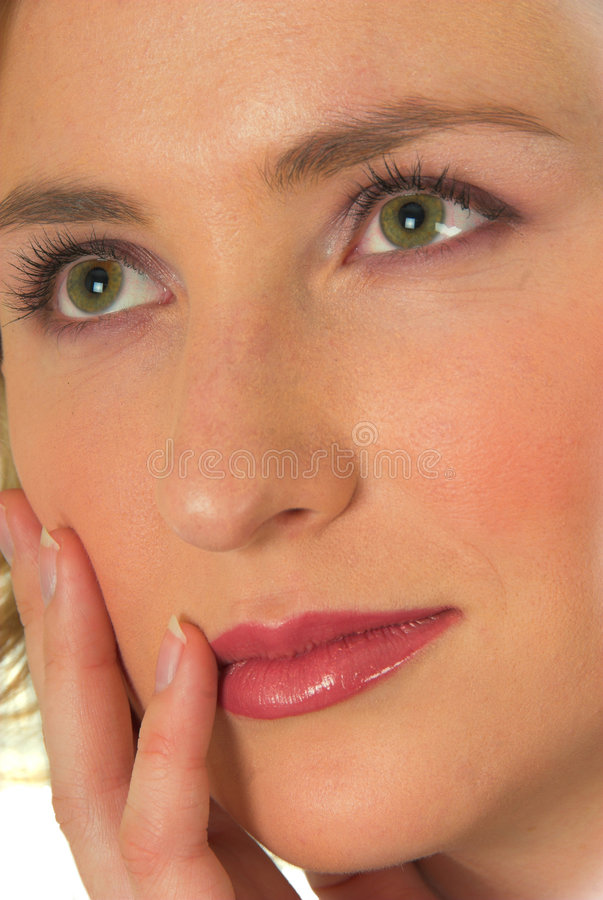 Blond woman green eyes #2. Blond woman with green eyes daydreaming stock image