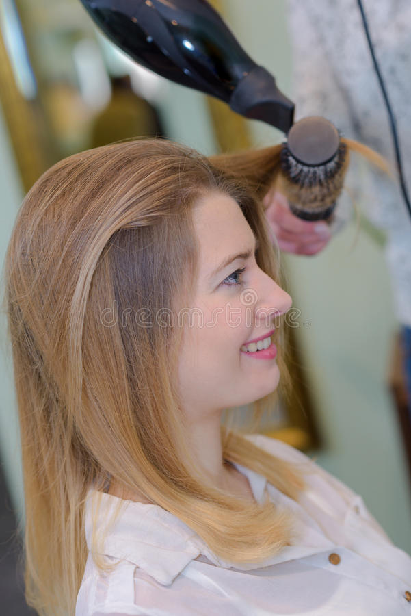 Blond woman at hairdresser stock photo