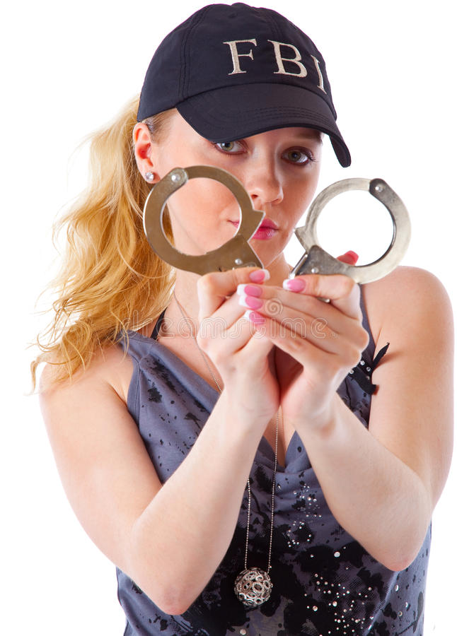 Blond woman with handcuffs stock photos