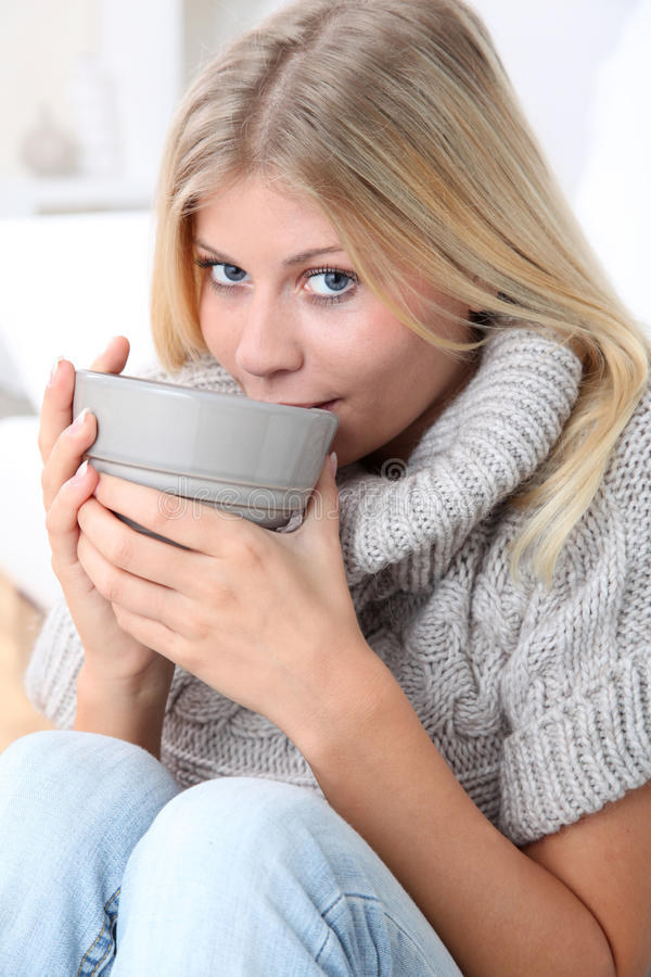 Blond woman holding bowl royalty free stock image