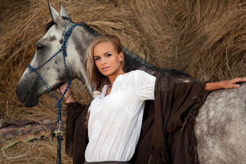 Download Blond woman with horse stock image. Image of hair, poses - 20635951