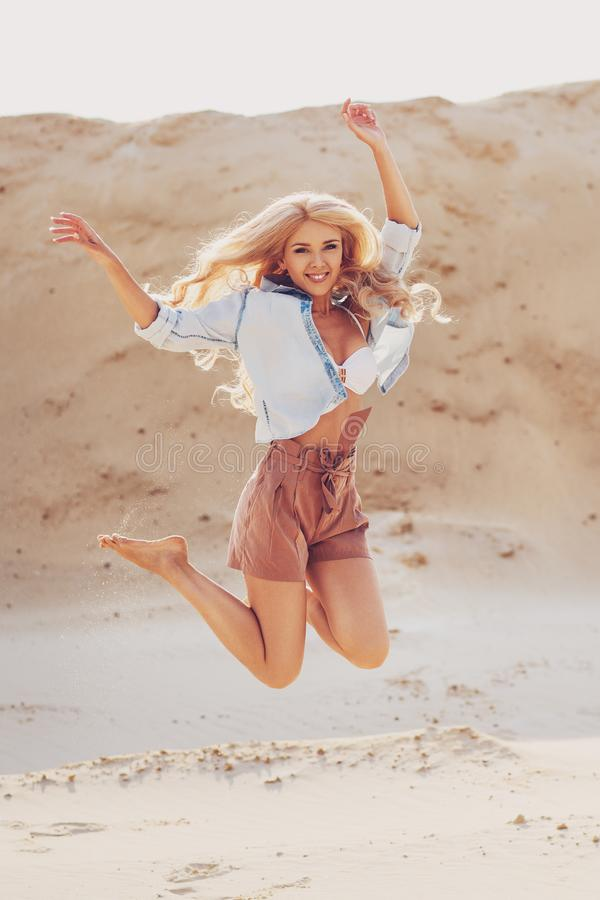 Blond woman jumping stock image