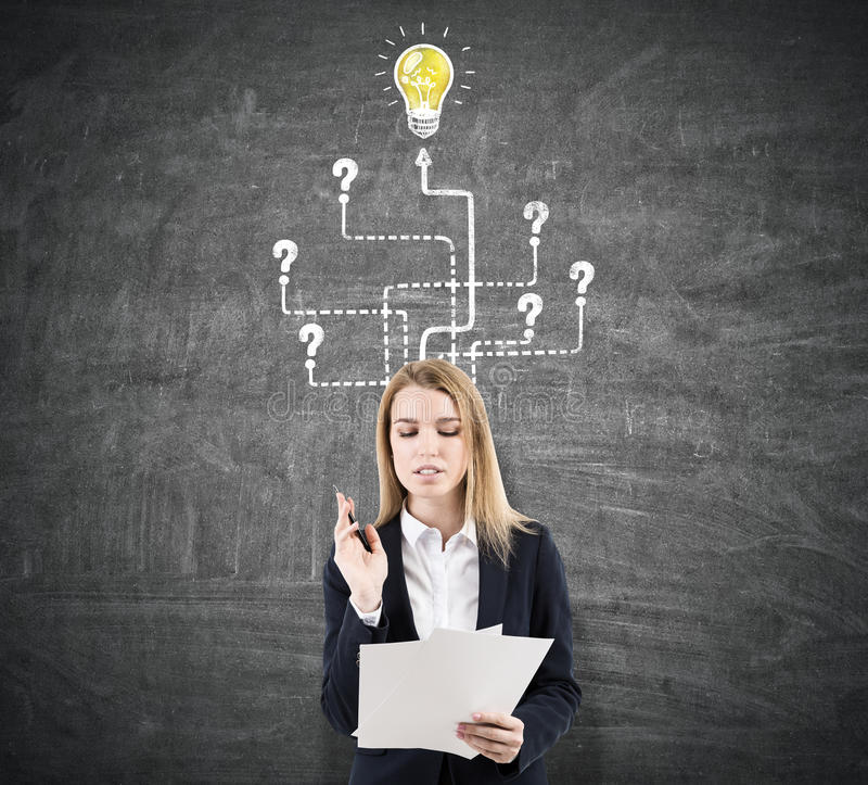 Download Blond Woman And Light Bulb With Arrows, Documents Stock Photo - Image: 83722732