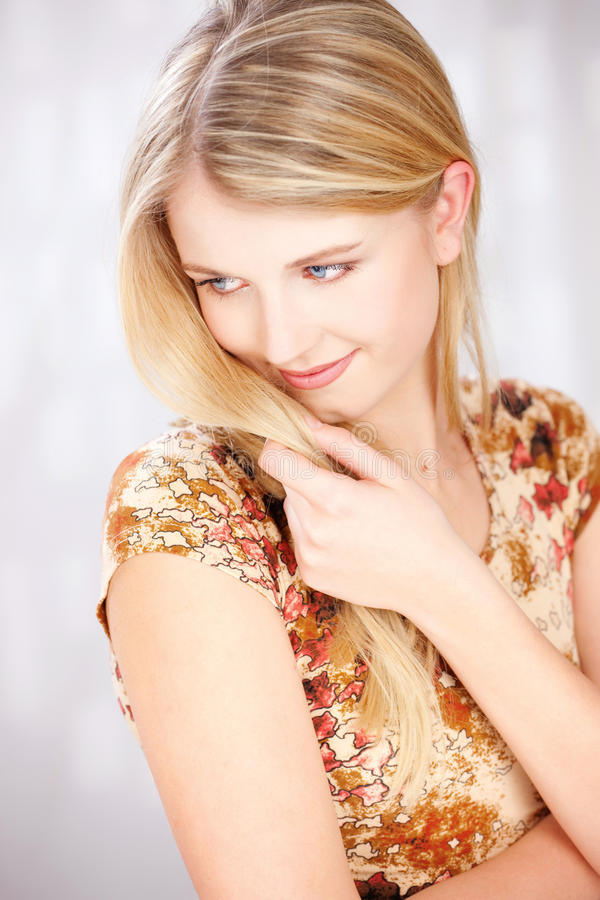 Blond Woman With Little Smile Royalty Free Stock Images